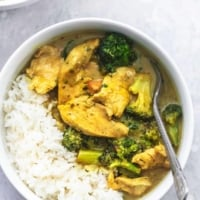 chicken and broccoli curry and rice in a bowl