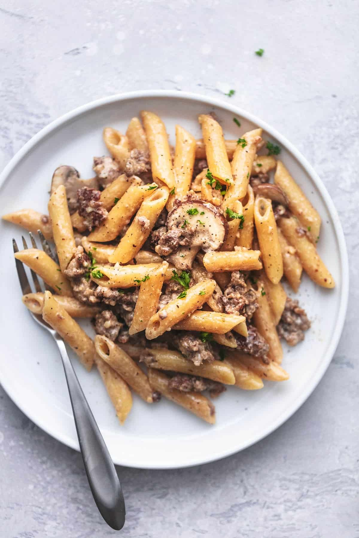 sausage and penne pasta on a plate