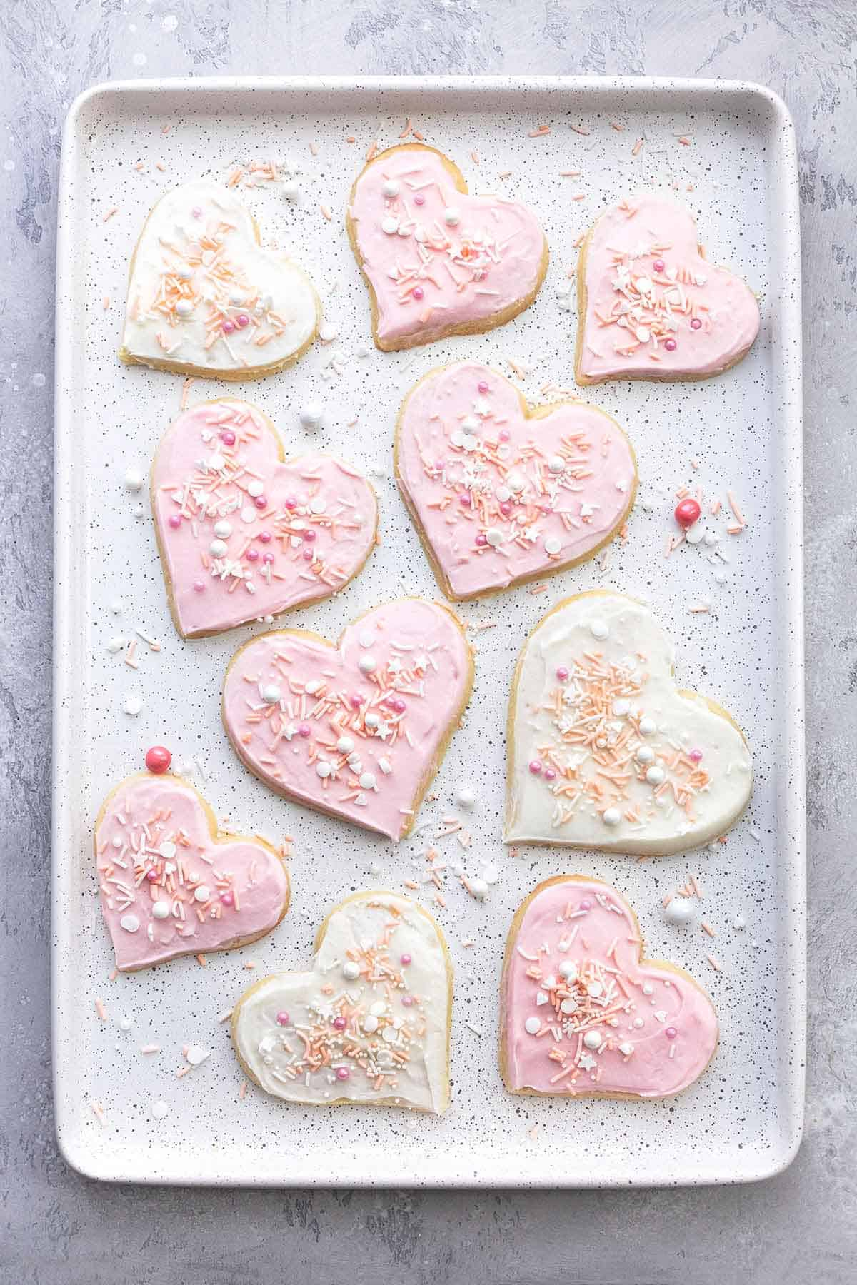 sugar cookies with sprinkles on a baking pan