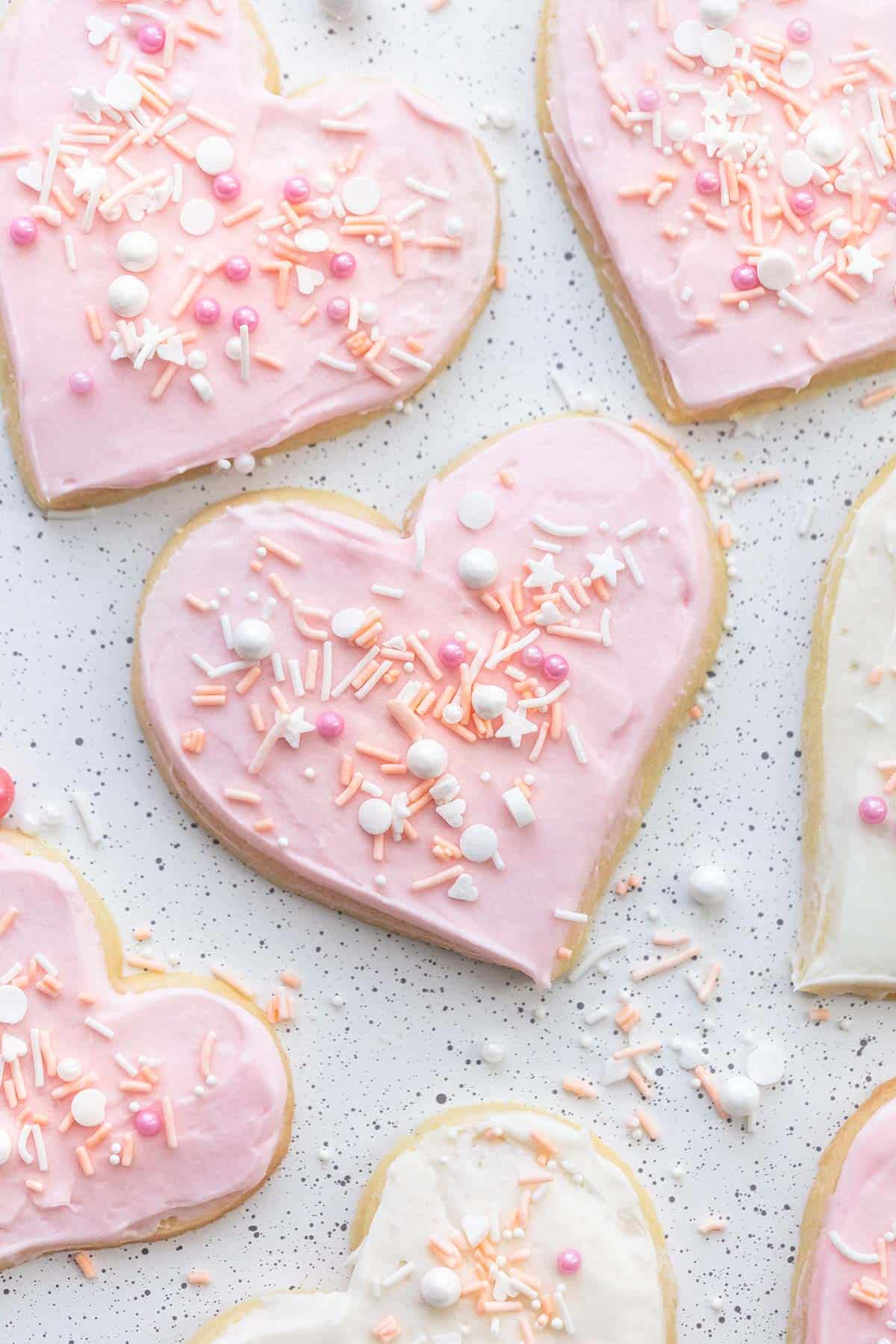 frosted heart shaped sugar cookies with sprinkles
