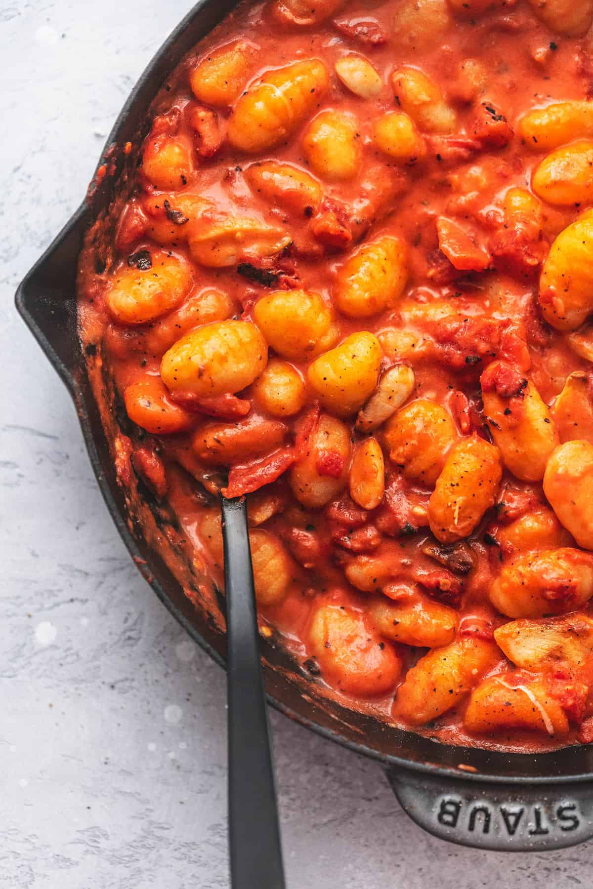 up close gnocchi with tomato sauce in a skillet