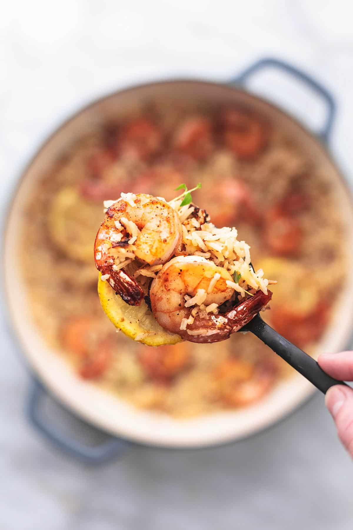 shrimp and rice with lemon on a spoon