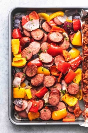sausage and bell peppers and onions on a pan