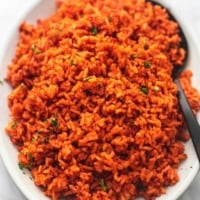 close up mexican spanish rice with a spoon