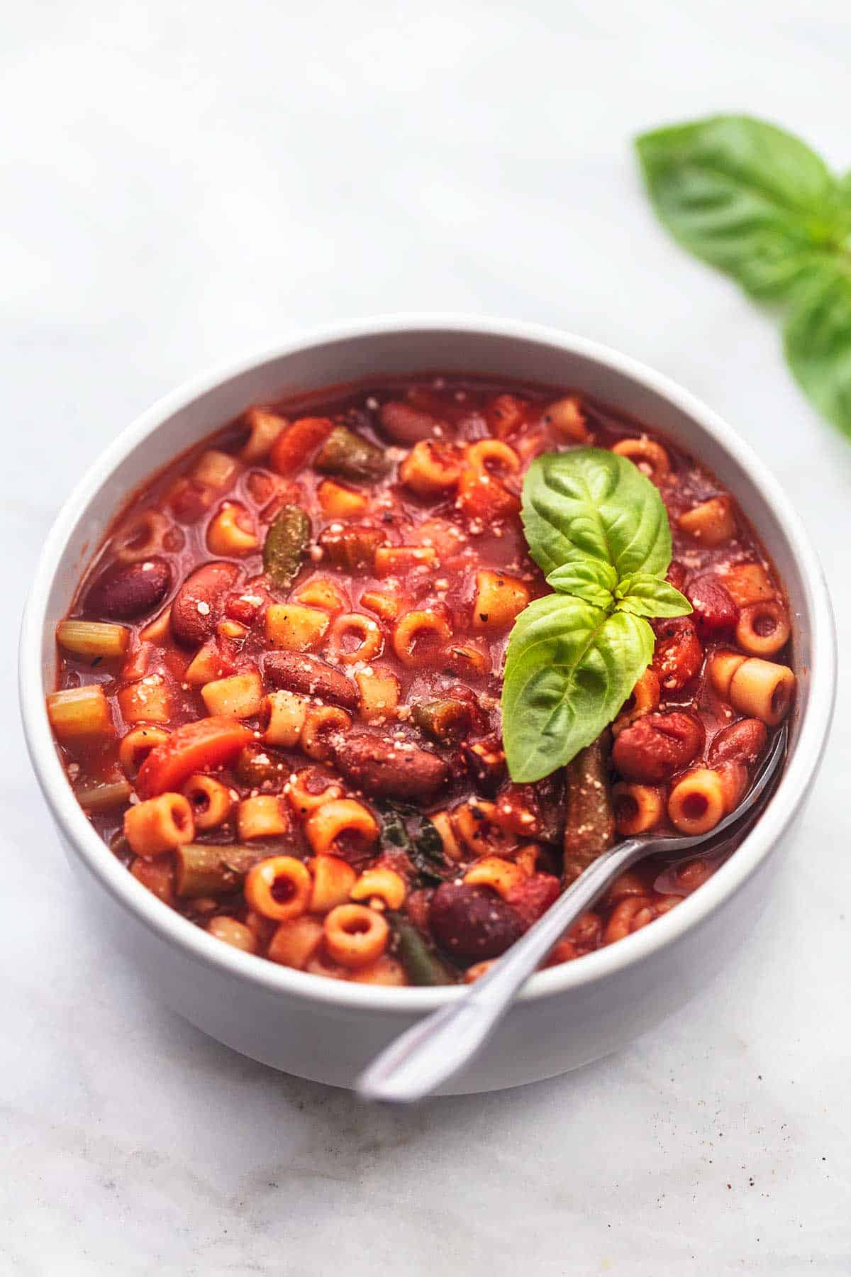 italian minestrone soup with spoon in a bowl