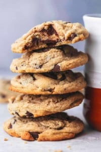 peanut butter cookies stacked against mug