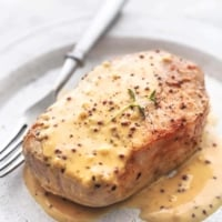 up close baked pork chops with honey mustard sauce