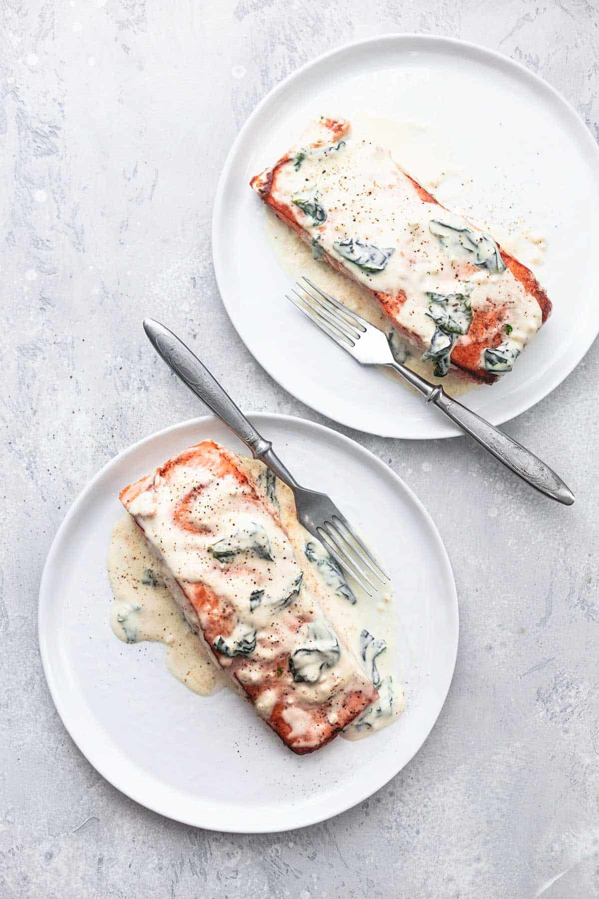 salmon florentine with a fork on two plates