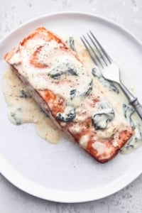 salmon florentine with a fork on a plate