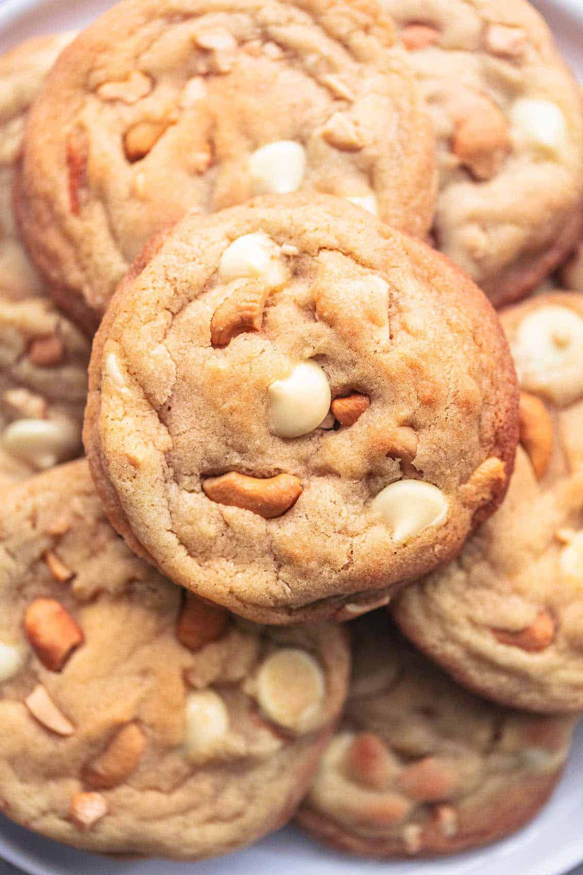 close up top view of chewy white chocolate cashew cookies.