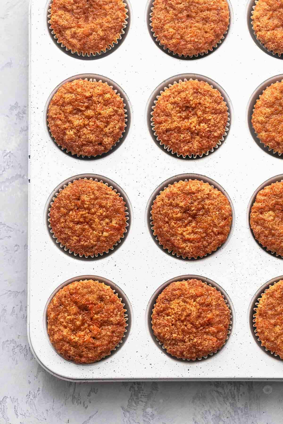 muffin tin with carrot muffins