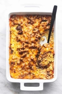 overhead breakfast casserole with a serving spoon in a baking dish