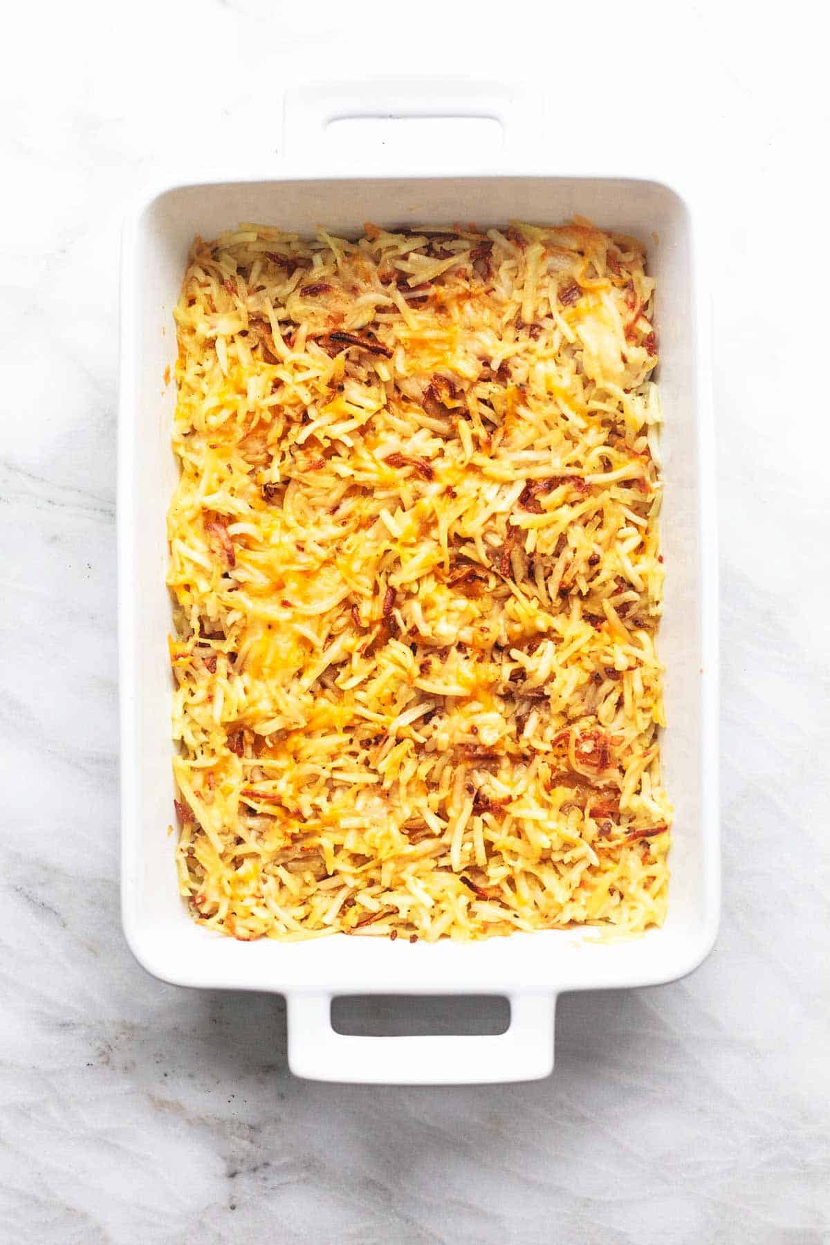 top view of cooked hash browns in a baking pan.