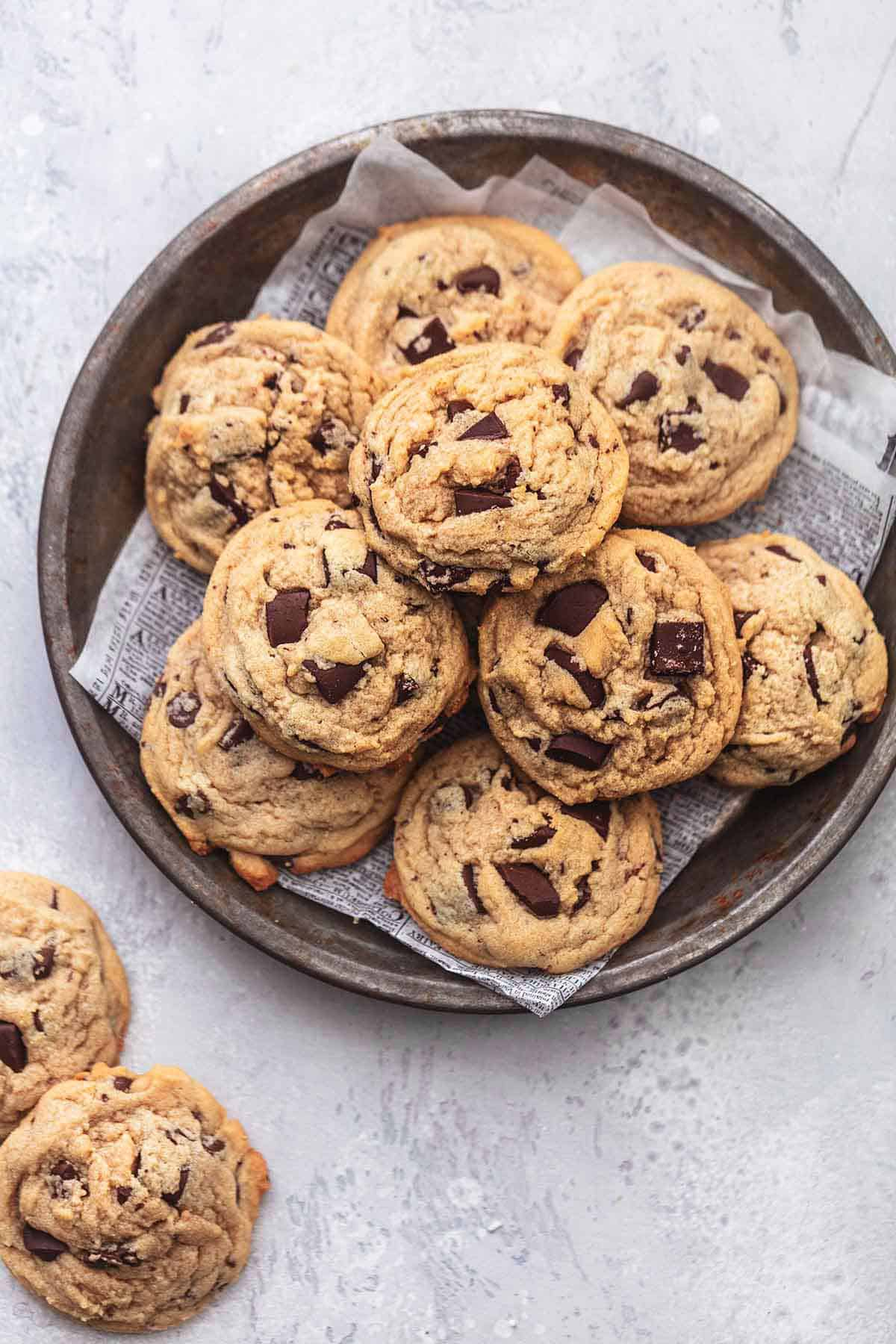 top view of peanut butter chocolate chunk cookies on a platter with more cookies on the side.