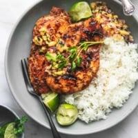 overhead chicken and pineapple salsa and white rice on gray plate