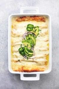 overhead white chicken enchiladas in white pan