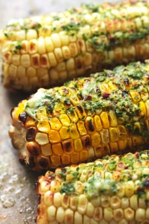 up close grilled corn with herb butter