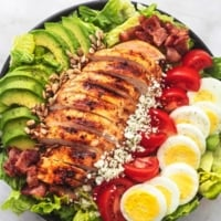 overhead view of chicken cobb salad with avocado and bacon in a bowl