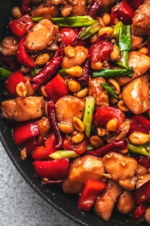 up close kung pao chicken in skillet