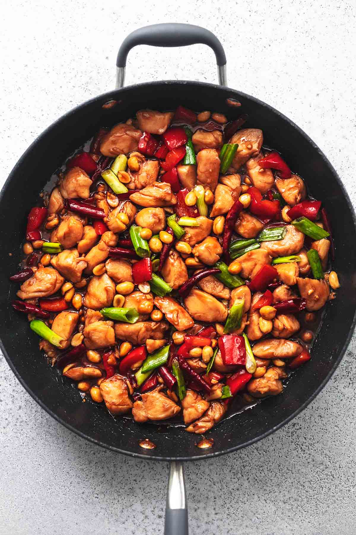 overhead kung pao chicken and veggies in skillet