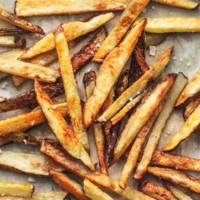 overhead french fries with salt on sheet pan