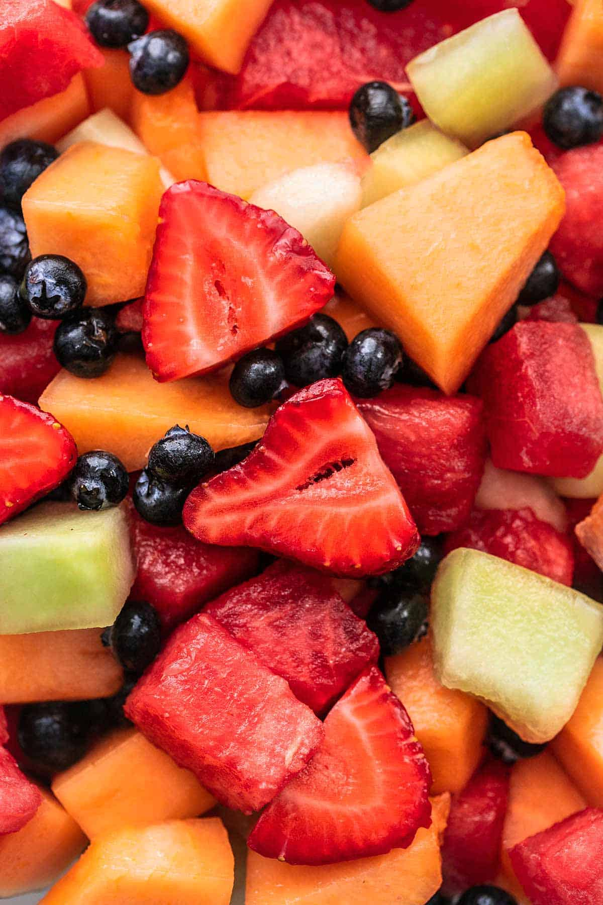 close up view of fruit salad with berries and melon chunks