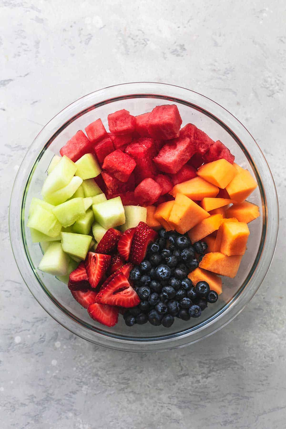 overhead view of unmixed, chopped fruit in bowl