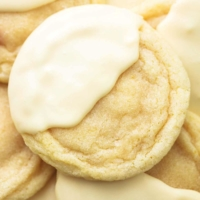 close up view of lemon sugar cookie dipped halfway in white chocolate