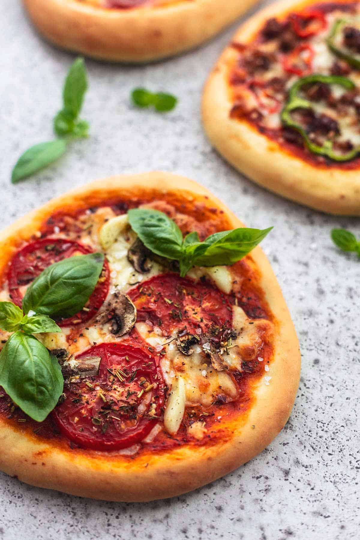 personal pizza with pepperoni and fresh basil