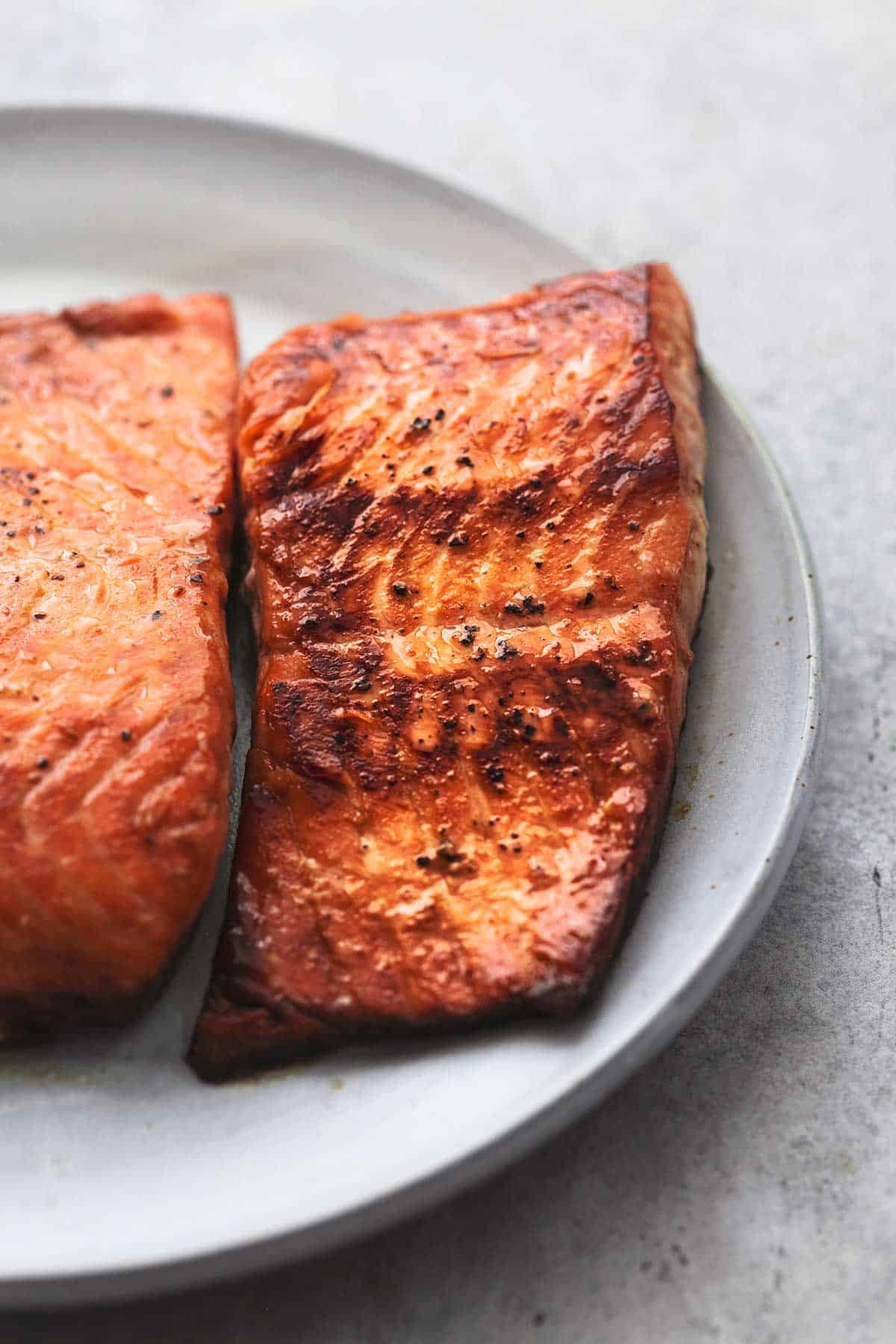 close up of cooked salmon on a plate.