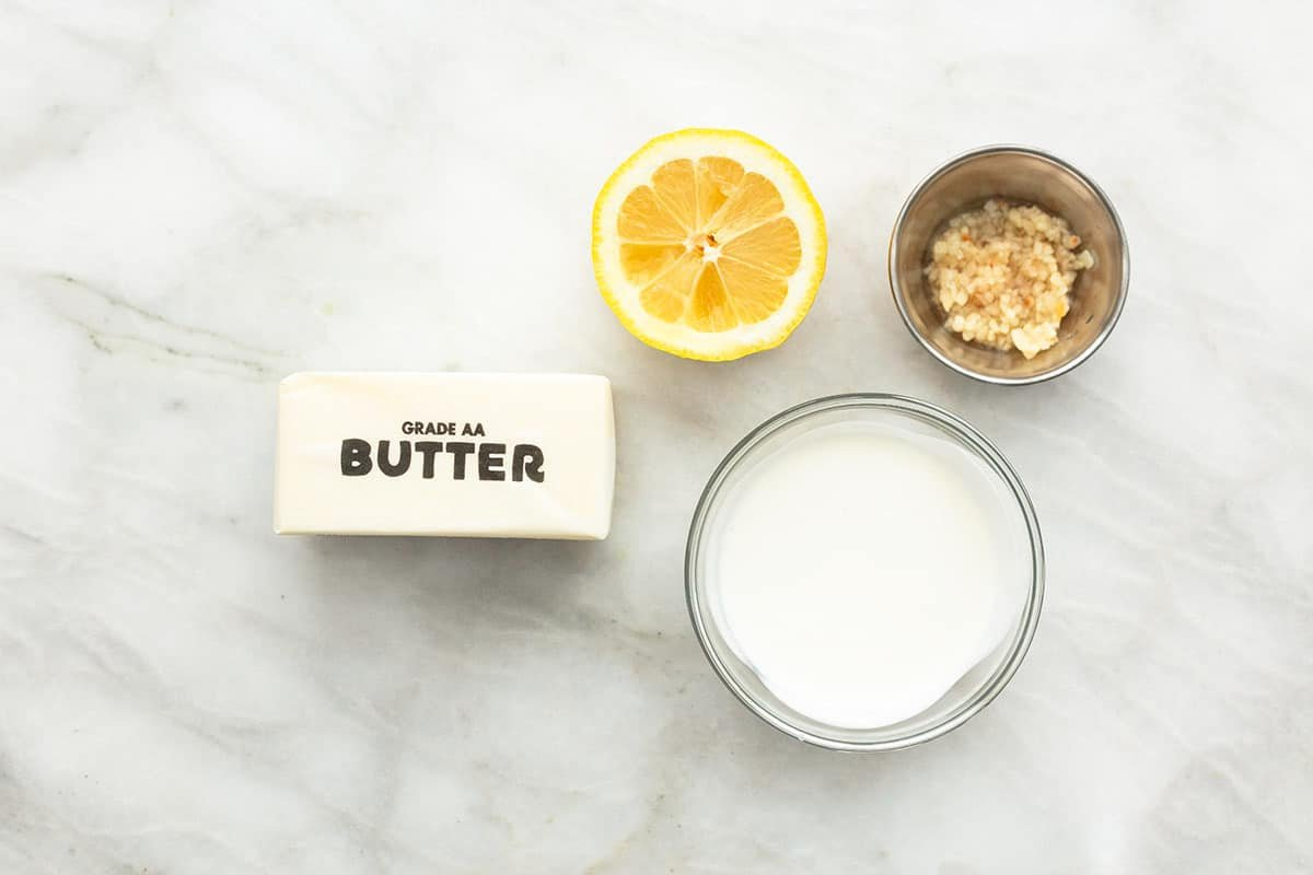 ingredients for lemon butter sauce on a tabletop