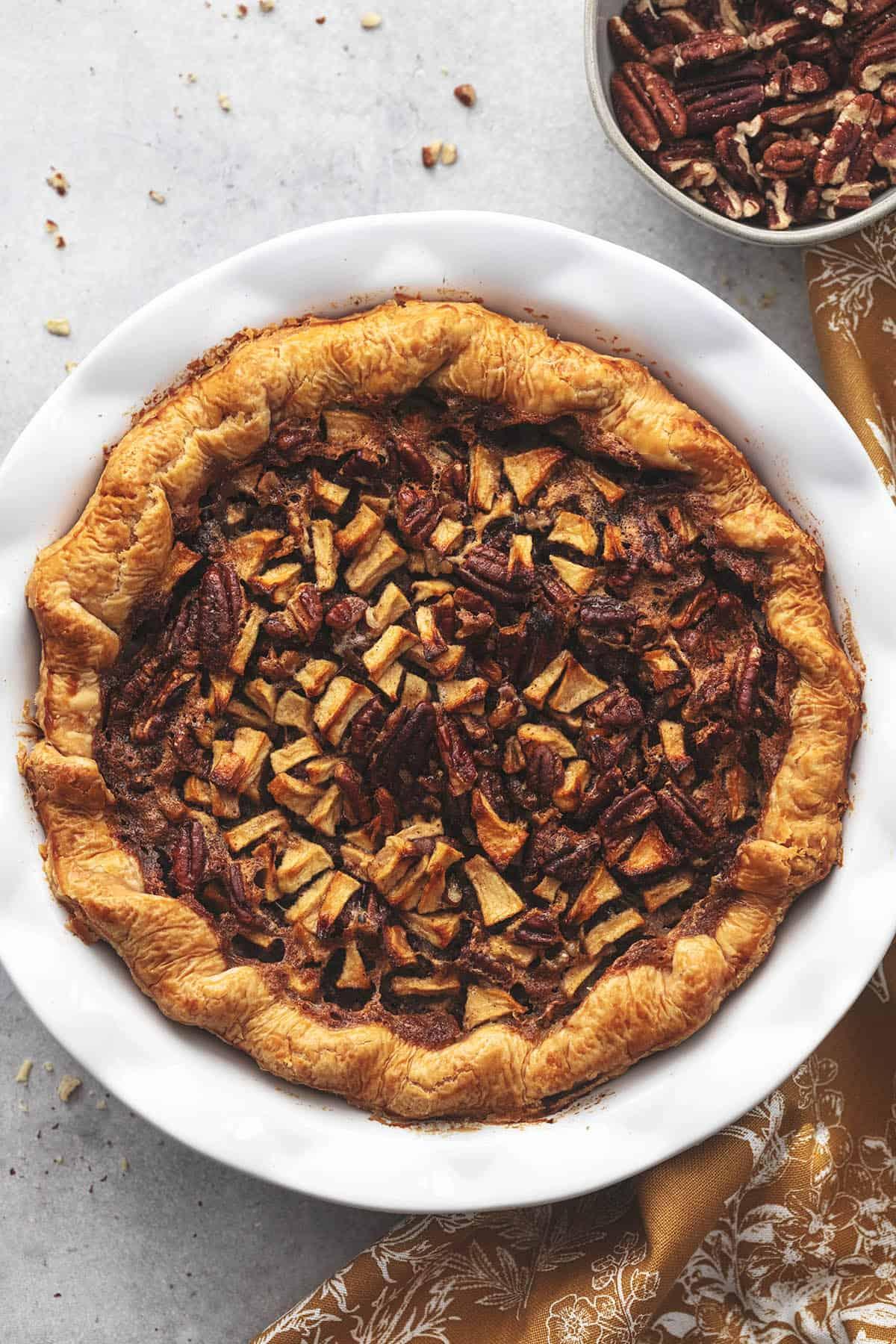 whole pecan pie in white pie dish