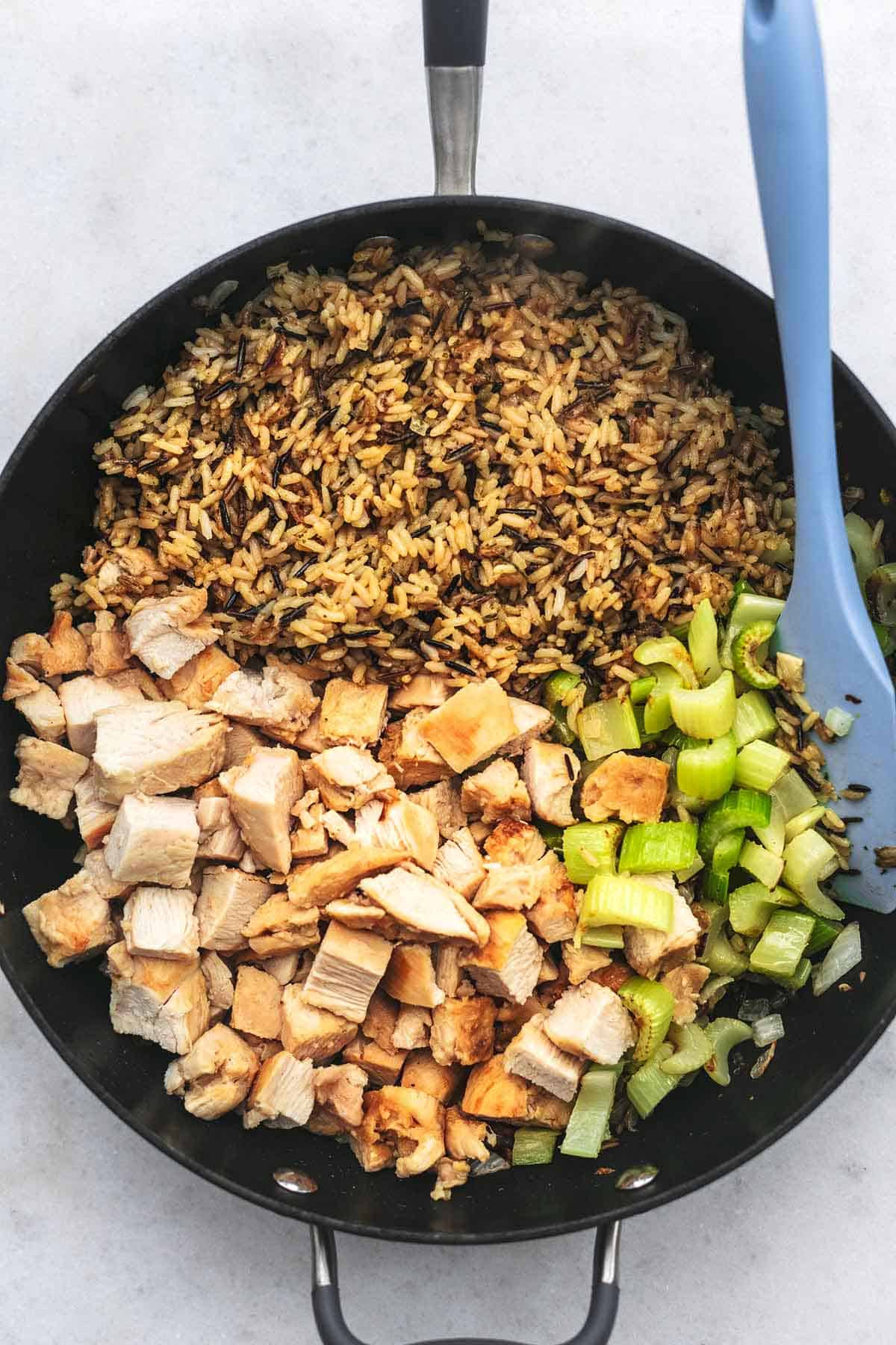 casserole preparation showing chicken, celery, and rice in a skillet