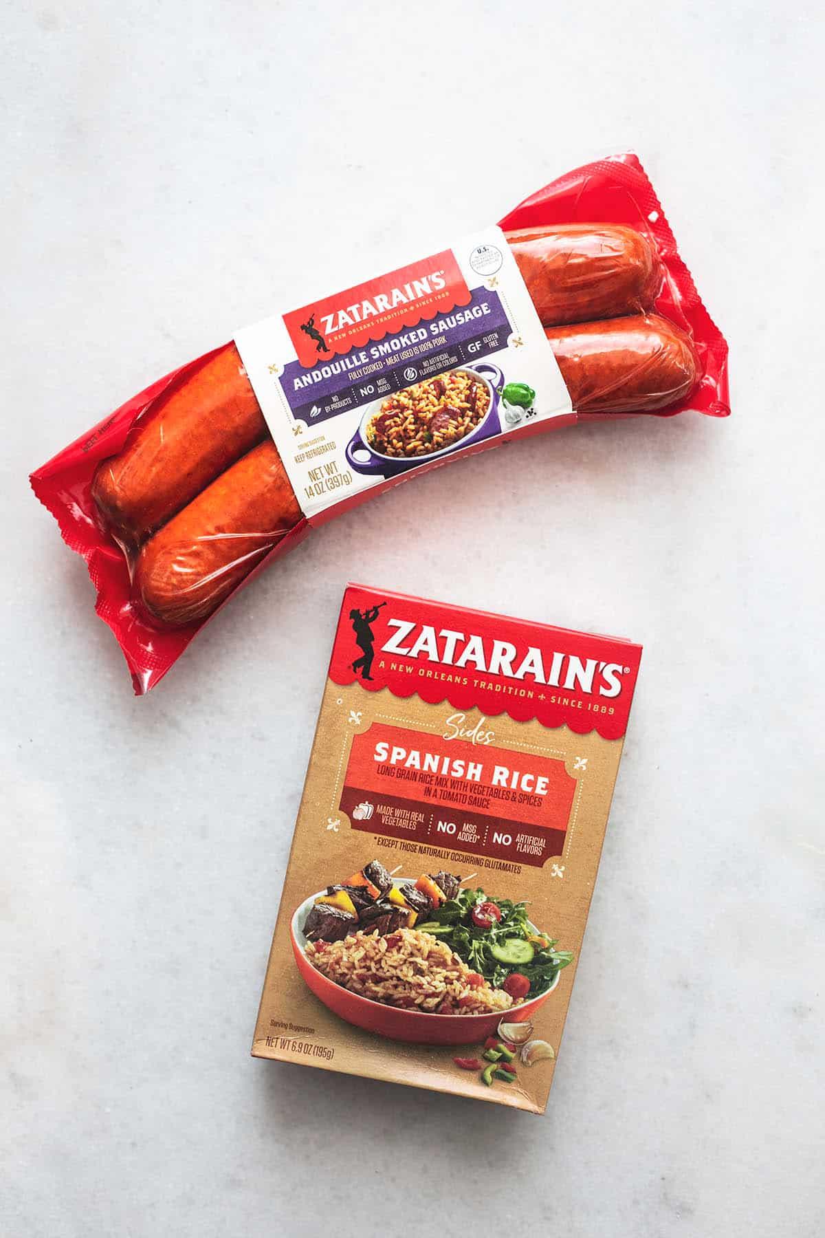 top view of a package of Zatarain's smoked sausage and Zatarain's Spanish rice box.