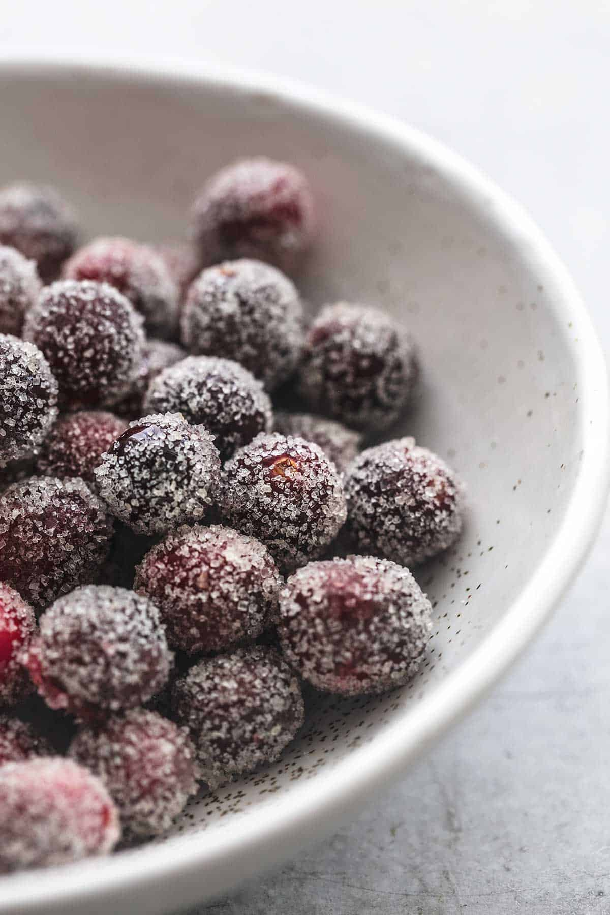 close up of sugared cranberries in a bowl.