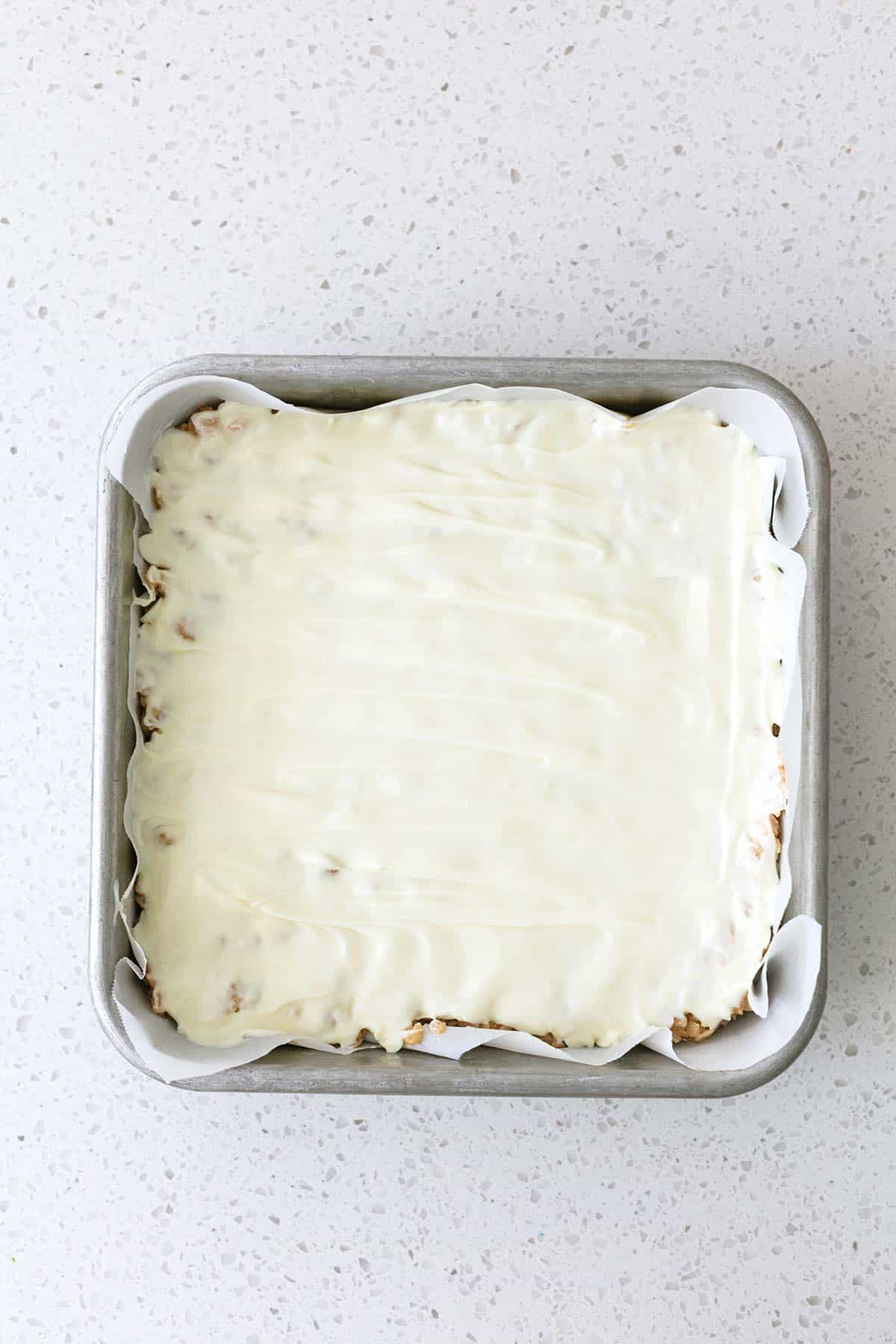 white chocolate melted in square pan
