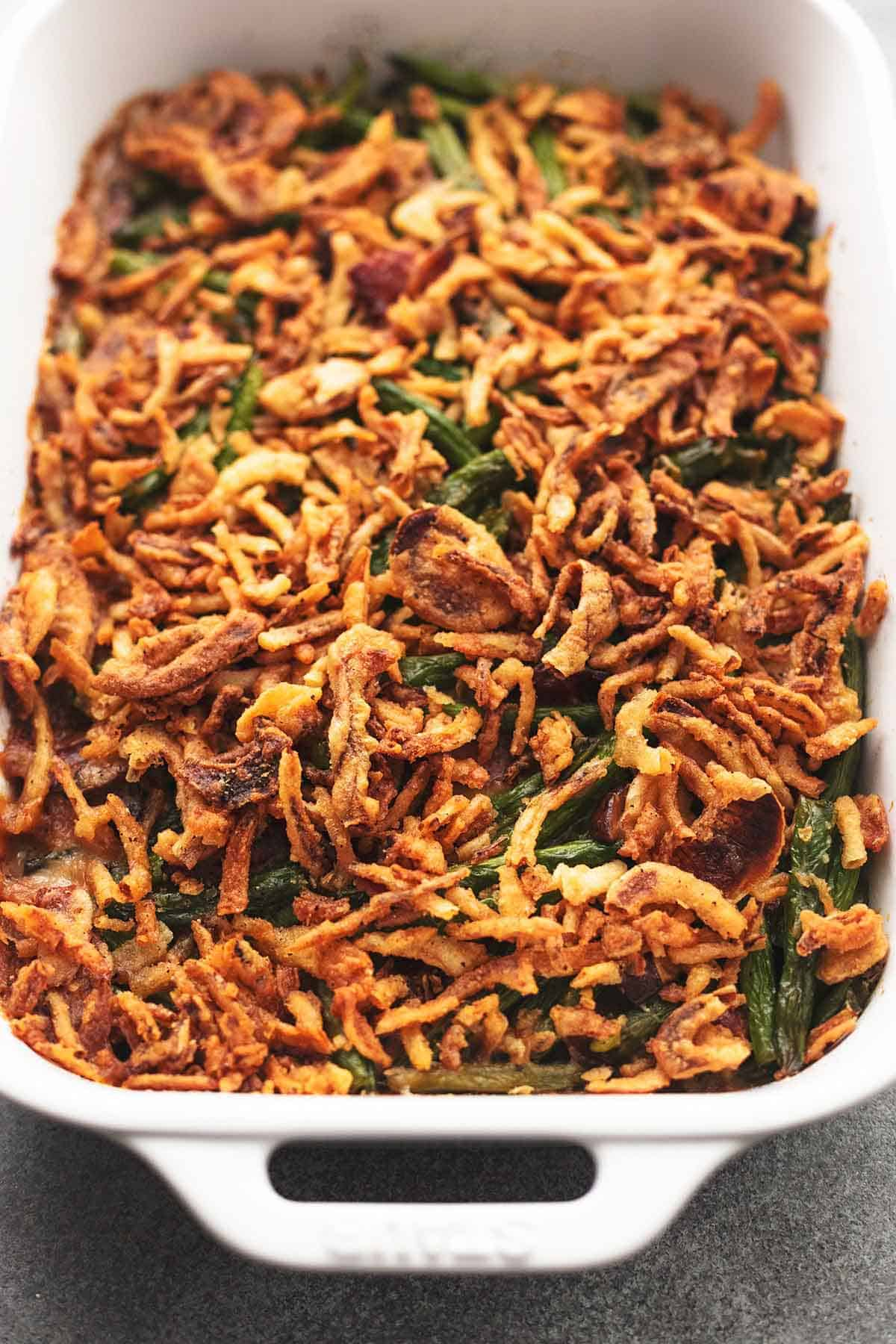 white casserole dish with crispy fried onions on top of green beans