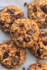 overhead view of six walnut and chocolate banana cookies