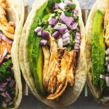 overhead view of shredded chicken tacos with onions and cilantro
