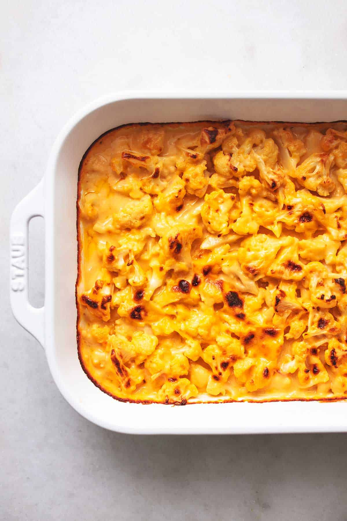 overhead white casserole dish filled with cheesy yellow sauce
