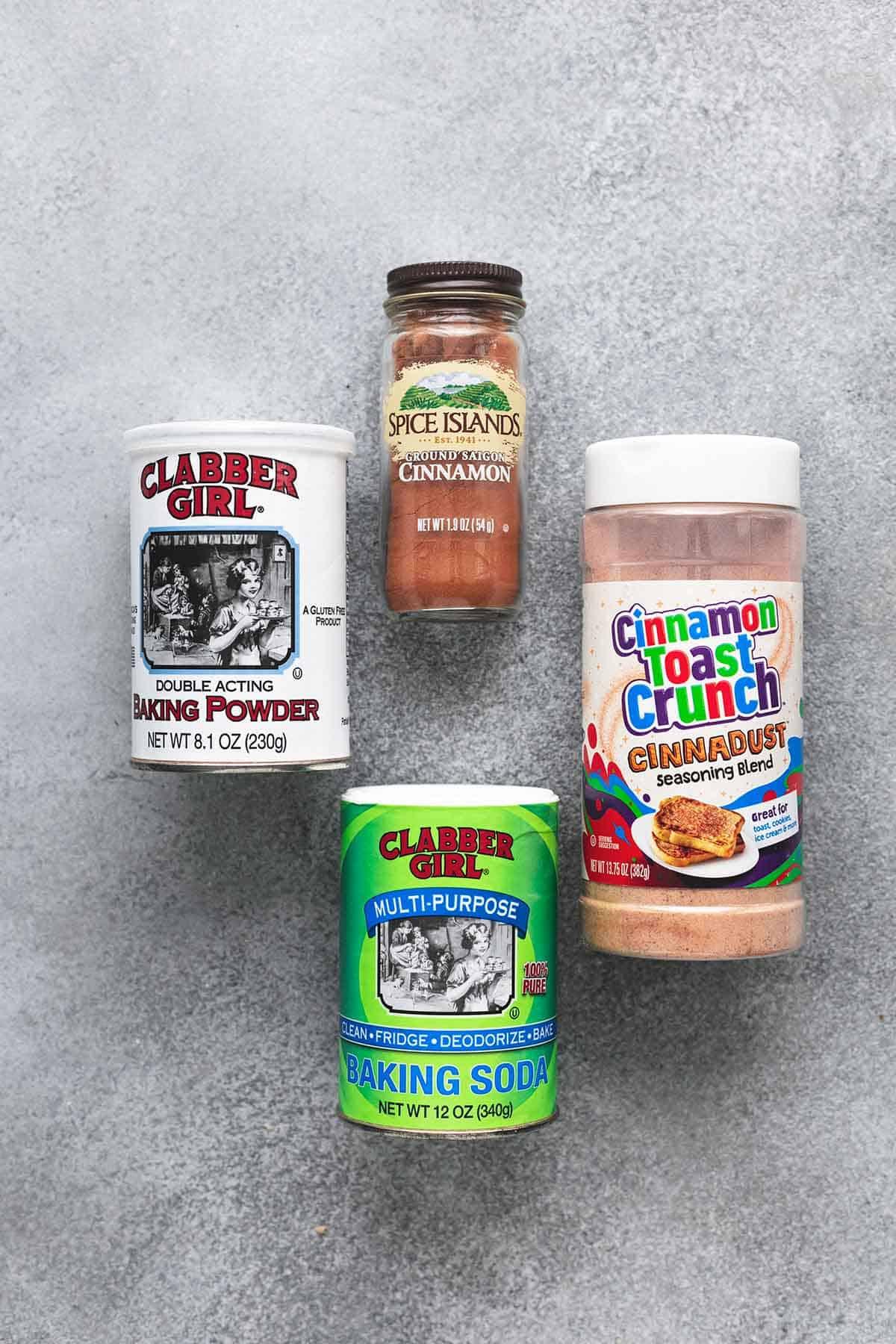 overhead view of cinnamon, cinnamon-sugar mix, baking soda, and baking powder