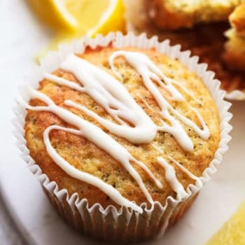 up close muffin with glaze and lemon wedges