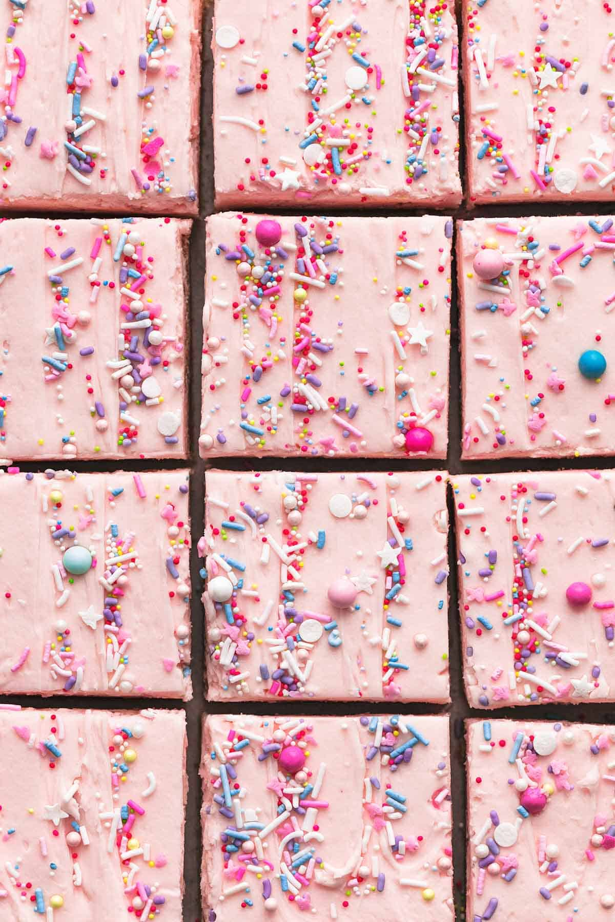 close up top view of sugar cookie bars cut into squares.