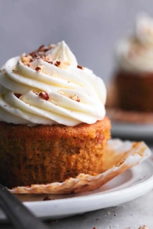 up close view of 3/4 of a single brown cupcake with white frosting