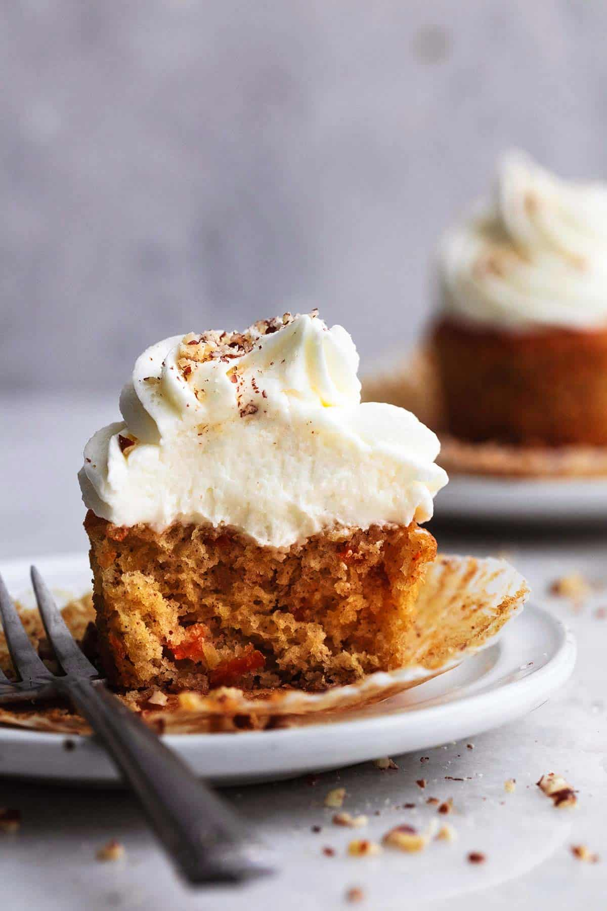 cross-section of a carrot cupcake with frosting