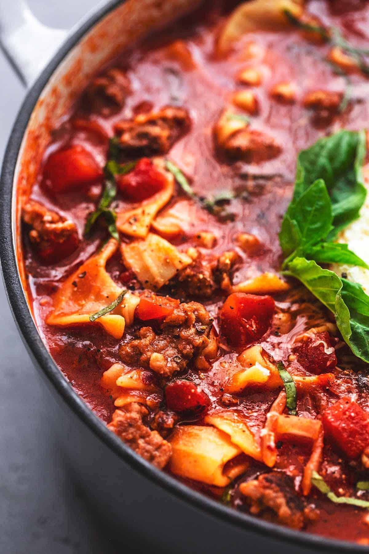 close up of lasagna soup in a pot.