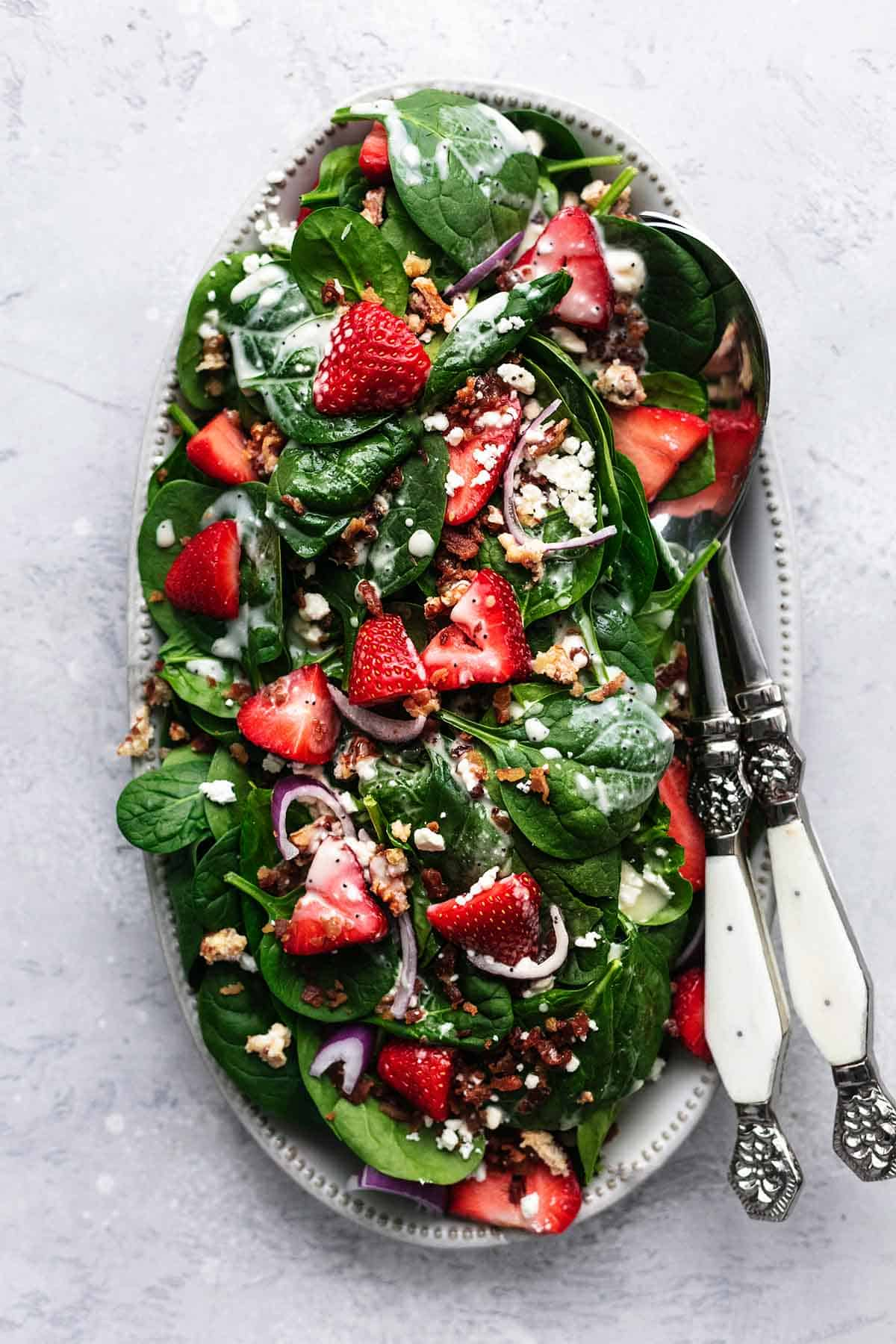 overhead view of strawberry spinach salad with poppy seed dressing