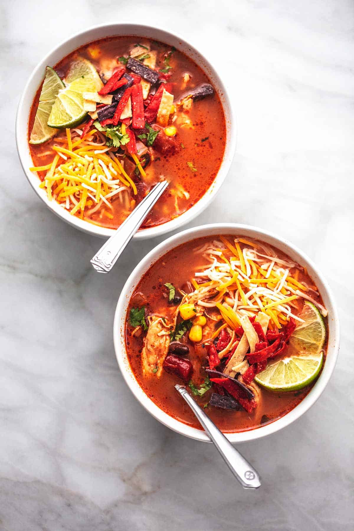 overhead view of two bowls with chicken tortilla soup