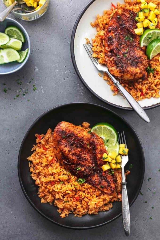 cajun chicken and rice on two plates