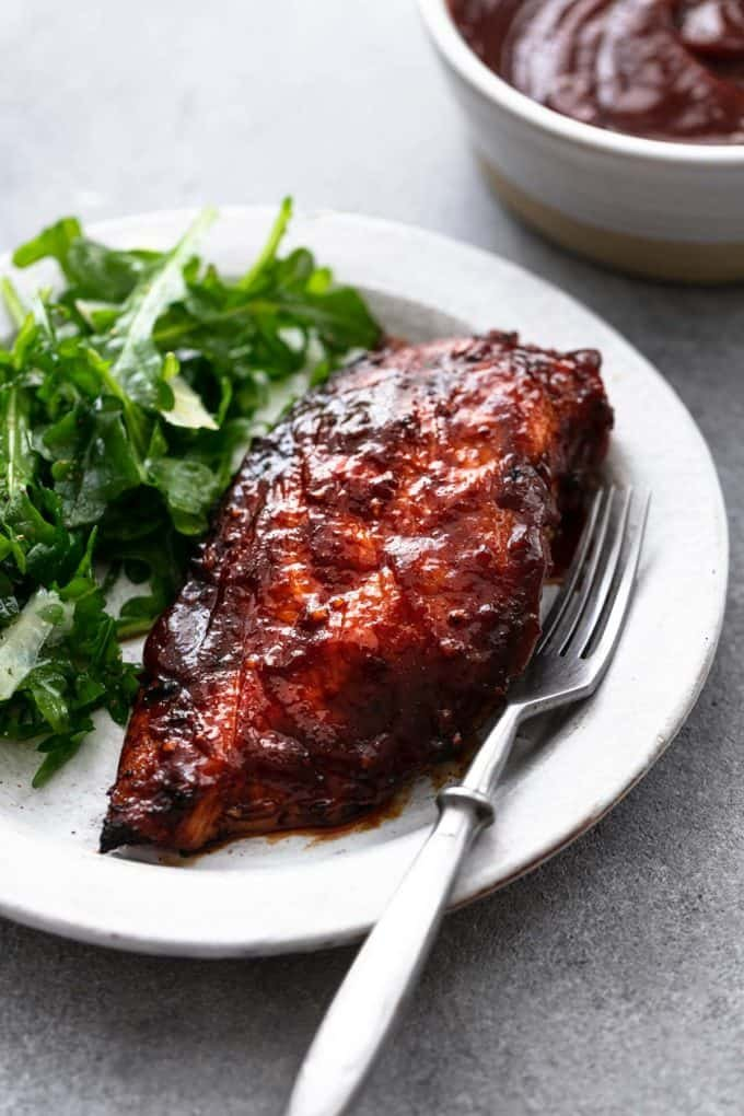 bbq chicken on plate with fork and greens